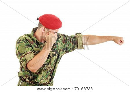 Soldier In Military Uniform And Cap Hitting With Fist