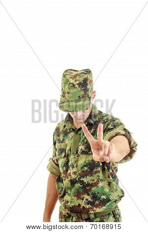 Soldier Uniform And Hat Standing And Showing The Peace Sign With His Hand
