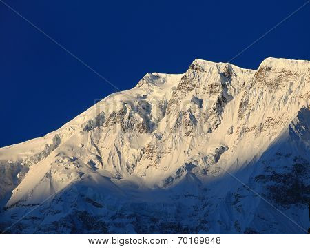 mountain peak in the Annapurna ridge at sunset, Himalayas, Nepal