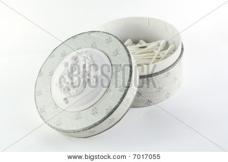 Box with ear cleaning sticks over white background