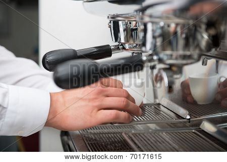 Barista doing your coffee