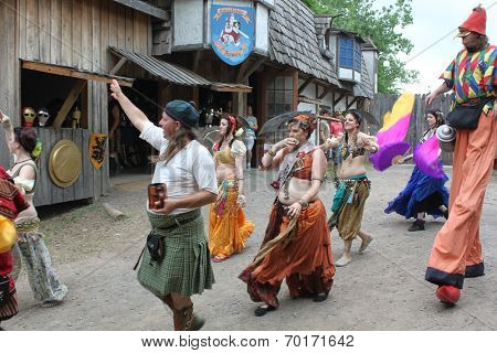 MUSKOGEE, OK - MAY 24: People dressed in historical costume walk at the village during the Oklahoma 19th annual Renaissance Festival on May 24, 2014 at the Castle of Muskogee in Muskogee, OK.