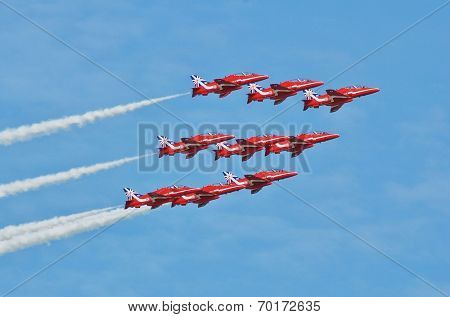 EASTBOURNE, ENGLAND - AUGUST 14, 2014: RAF aerobatic team The Red Arrows perform at the annual free Airbourne airshow. Formed in 1965, the team are celebrating their 50th display season.