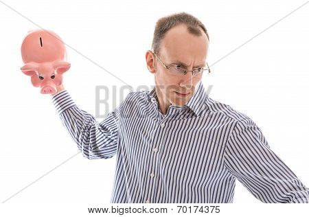 Furious Isolated Bald Man Smashing His Piggy Bank.