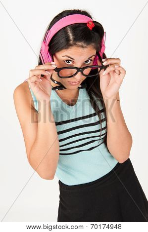 Cute Nerdy Girl Listening To Music Whilst Looking At Camera. Teasing.