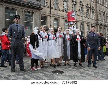 EDINBURGH- AUGUST 16: Members of The About Turn Theatre Company publicize their show Dido and Aeneas during Edinburgh Fringe Festival on August 16, 2014 in Edinburgh Scotland
