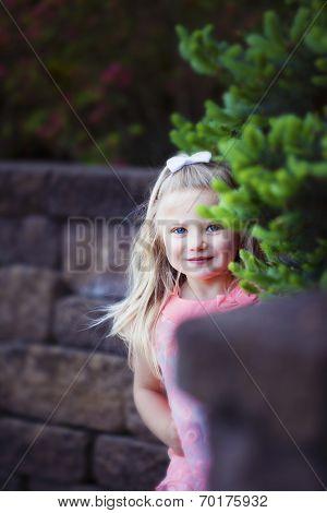Happy Girl Peeks Around