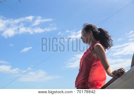 happy young girl leans on wooden boat