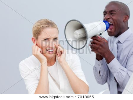 Angry Businessman Shouting Through A Megaphone