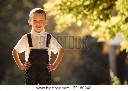 Cute Smiling Young Boy Backlit By The Sun