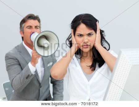 Competitive Businessman Shouting Through A Megaphone