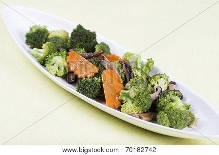Three Vegetables (broccoli, Mushroom, Carrot) On The Plate