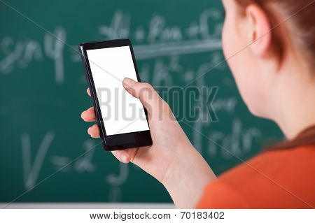 College Student Using Smart Phone In Classroom