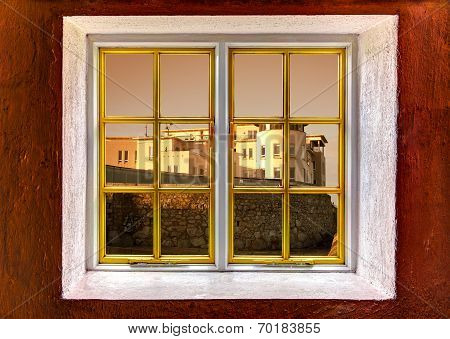 View Of A Mansion Through A Window