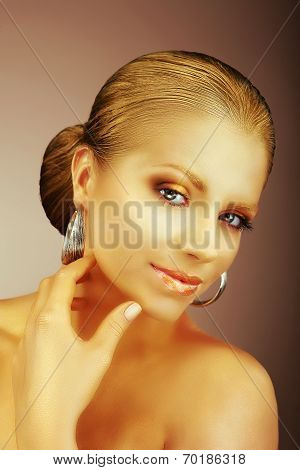 Fascinating Lady With Silver Earrings And Silky Golden Skin