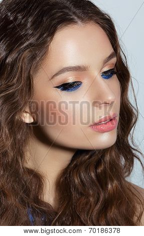 Visage. Pensive Woman With Blue Mascara And Holiday Makeup