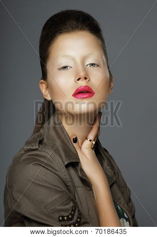 Elegance. Woman With Trendy Makeup