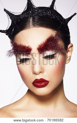 Glamor. Eccentric Woman With Surreal Theatrical Hairdress