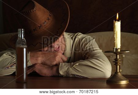 Mature man in cowboy hat