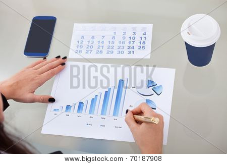 Businesswoman Analyzing Graph