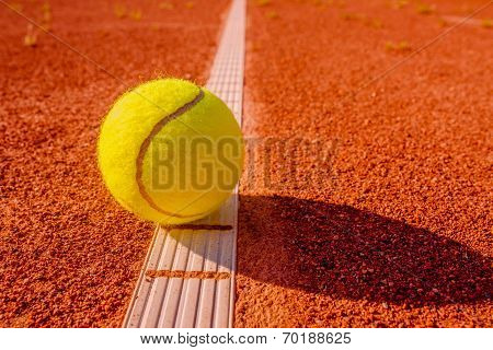 Yellow Tennis Ball Touching The Line