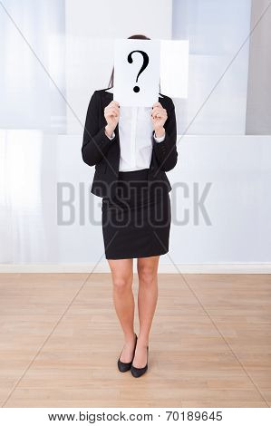Businesswoman Holding Question Mark Sign