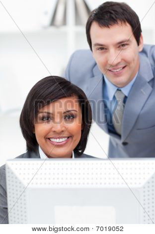 Two United Colleagues Working At A Computer