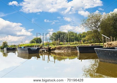 Wooden Boats Near Gangways On Lake, France