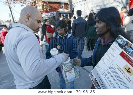 NEW YORK - JAN 1:  Volunteers collect donations for Sri Lankan tsunami victims outside of the Hindu Ganesh Temple January 1, 2005 in Flushing, NY.