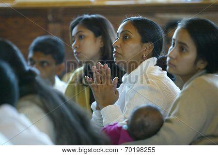 NEW YORK - JAN 1:  Rupali Barua (M), Papri Barua (L) and Shamali Barua (R) attend an interfaith ceremony at the Buddhist Vihara Temple to aid tsunami victims January 1, 2005 in Queens Village, NY.