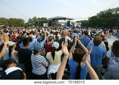 NEW YORK - JUNE 25:  People pray as they attend the Greater New York Billy Graham Crusade in Flushing Meadow Corona Park June 25, 2005 in the Queens borough of New York City.