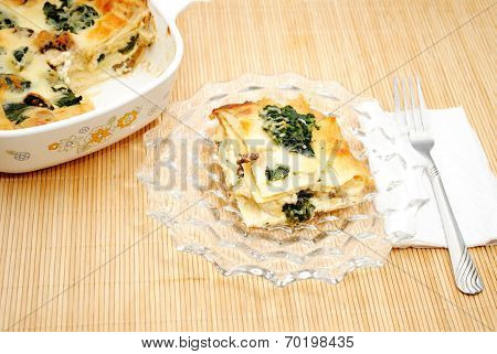 Homemade Spinach Lasagna Served On A Glass Plate
