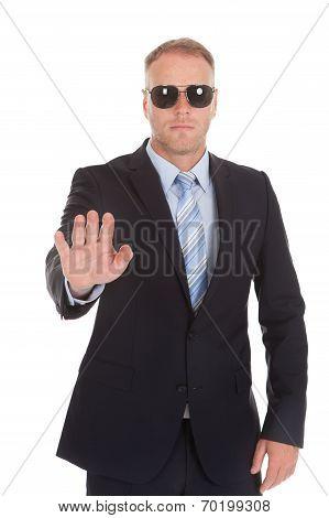 Confident Bodyguard Making Stop Gesture