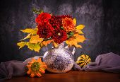 stock photo of chrysanthemum  - Still life with autumn chrysanthemum flowers in a vase - JPG
