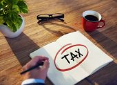 stock photo of income tax  - Businessman Writing the Word  - JPG