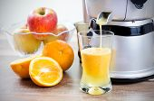 stock photo of fruit-juice  - Juicer and orange juice - JPG