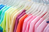 stock photo of wardrobe  - A row of colorful row t - JPG