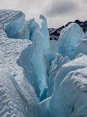 picture of crevasse  - Light shining through a section a Matanuska Glacier in Alaska - JPG