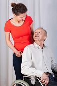 image of granddaughter  - Vertical view of grandfather looking on granddaughter - JPG