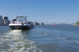 picture of ijs  - barge on the amsterdam IJ heading towards the North Sea - JPG