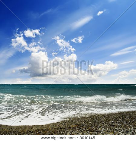 Clear summer sea scape - baech and cloudy sky