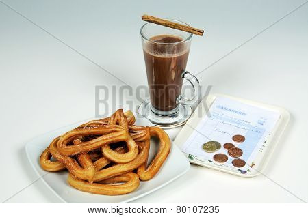 Churros with chocolate.