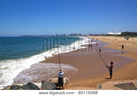 City Skyline And Beach Fishermen In Durban