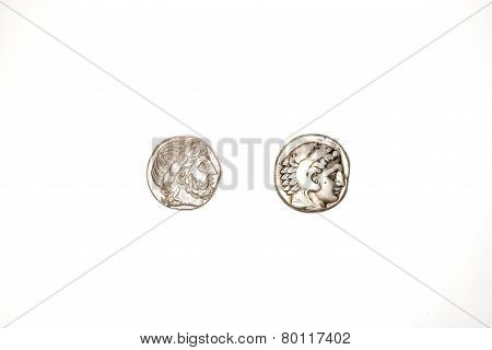 Two Ancient Silver Coins On White Background