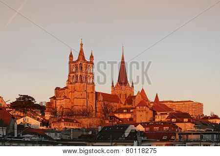 Switzerland. Lausanne. View Of The Gothic Cathedral, Sunset.