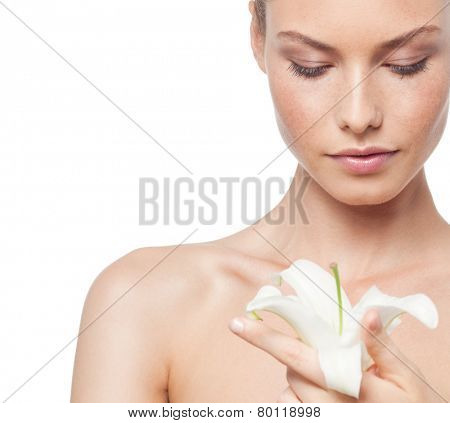 closeup portrait of attractive  caucasian  woman brunette isolated on white studio shot lips  face head and shoulders looking down flower