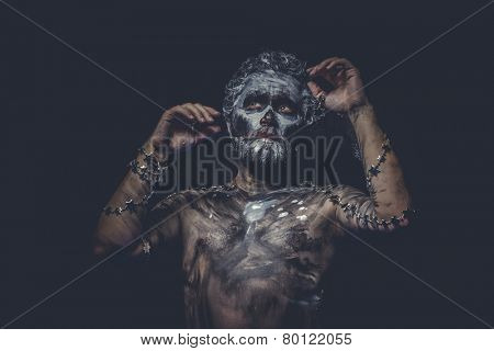 naked wild man with tribal paint