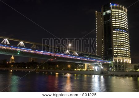 Moscow business center and bridge over river, night scene