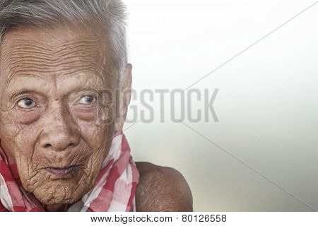 Old Man Face Closeup Eyes Looks At Camera