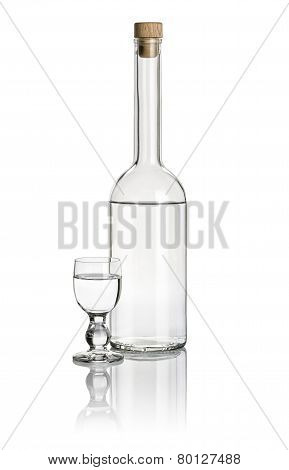 Liquor bottle and glass goblet filled with clear liquid